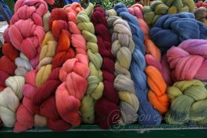 Hand dyed wool roving -photo by Carla Schauer