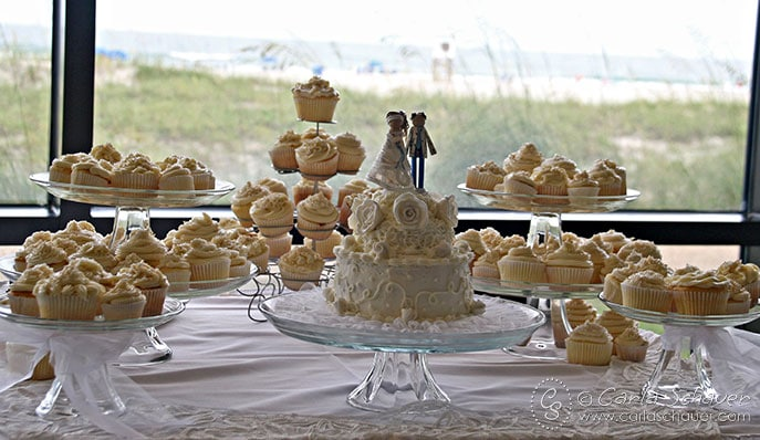 Crafty handmade wedding cake and cupcake table