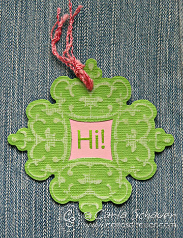 Sanded and embossed die cut paper gift tag