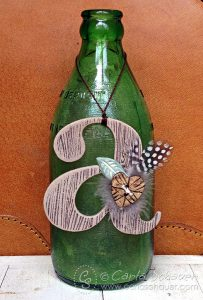 Woodgrain print chipboard monogram tag. Tutorial from Carla Schauer Designs.
