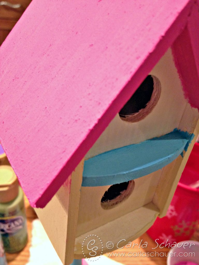 Applying acrylic paint to birdhouse-Carla Schauer Designs