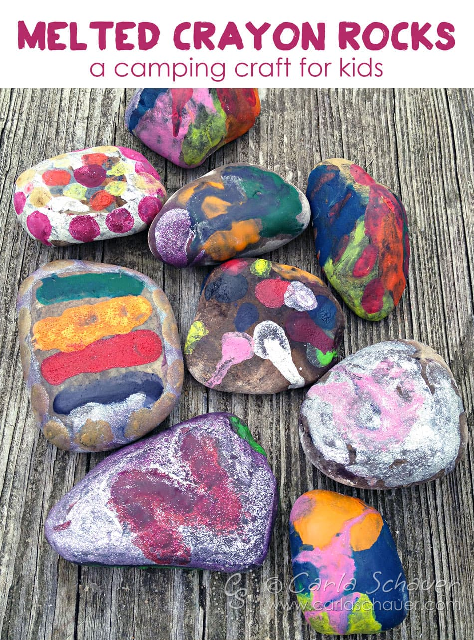rocks covered in melted crayons on wood table with text above for pinning.