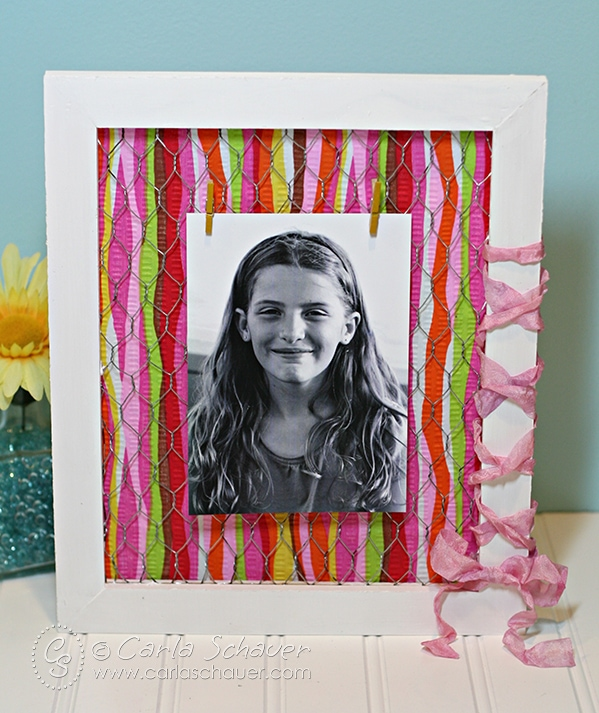 Make a colorful scrap fabric photo frame using your fabric stash. Tutorial from Carla Schauer Designs.