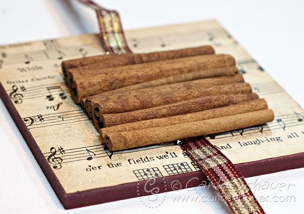 Christmas ornament made with sheet music and cinnamon sticks. Tutorial from Carla Schauer Designs.