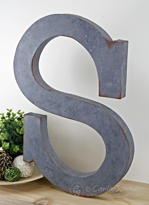 Make a faux-metal monogram with paint. Tutorial from Carla Schauer Designs.