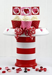 DIY Valentine Cupcake Stand made from terra cotta pots. Adorable idea! Tutorial from Carla Schauer Designs
