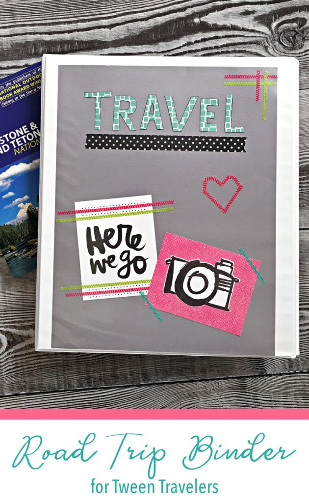DIY travel binder with gray cover on wood table.