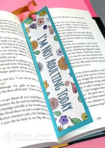 Make a bookmark using finished coloring pages. Instructions at carlaschauer.com