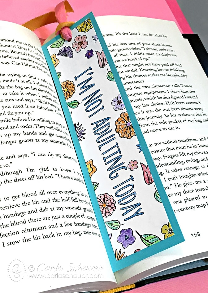 Make a coloring page bookmark using finished pages from your adult coloring books. Instructions at carlaschauer.com