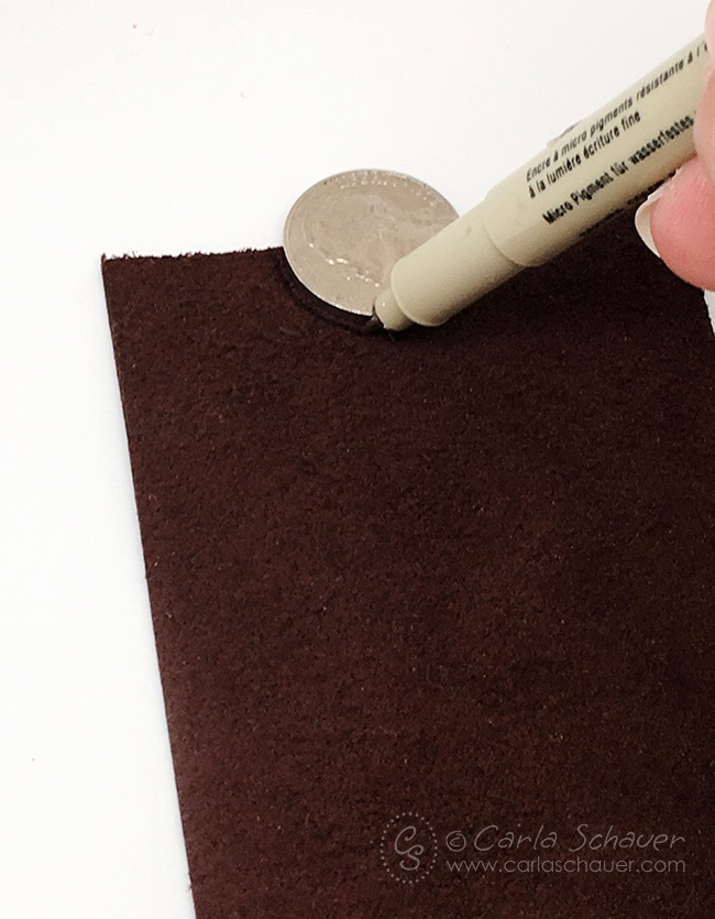Cut 2 leather pieces and make a slim wallet in less than 15 minutes. Such an easy gift for men for Father's Day or Graduation. Tutorial from Carla Schauer Designs.