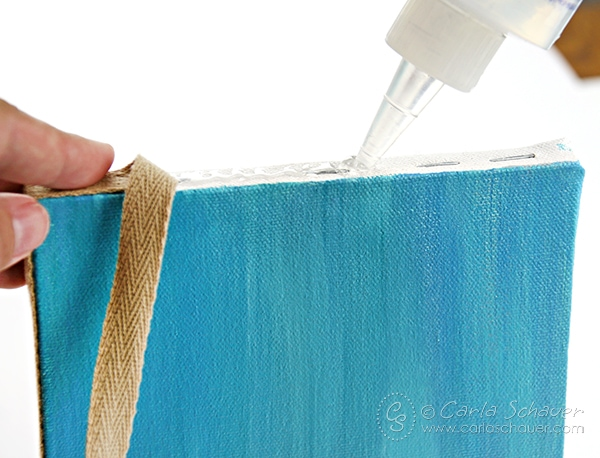 Wrap edges of canvases for a neat finishing touch. Coastal Canvas home decor tutorial from Carla Schauer Designs