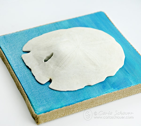 Paint coastal decor canvases and add beach finds for beachy home decor. Tutorial from Carla Schauer Designs