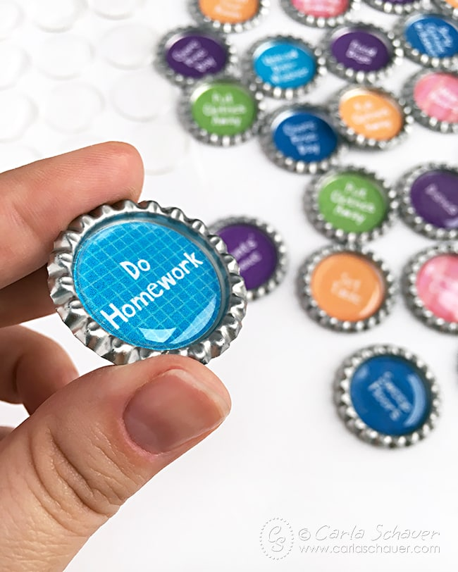 Make chore chart magnets from bottlecaps and epoxy circles. Great tutorial from Carla Schauer Designs