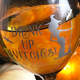 Drink up witches! Customize wine glasses for a Halloween party. Free cutting file from Carla Schauer Designs