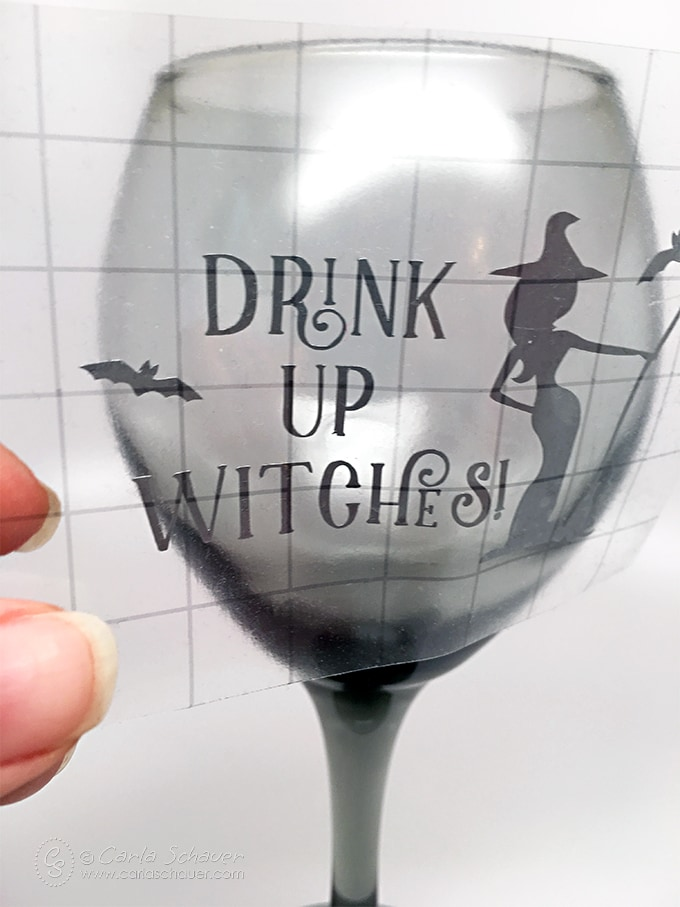 Snarky DIY Halloween wine glasses using a fun free cut file.