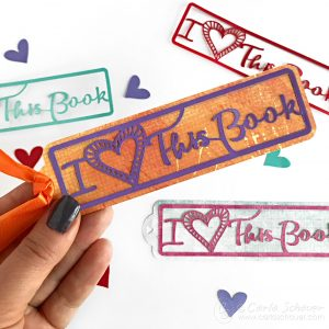What a cute Idea for classroom valentines! Make a bookmark with a free svg cut file. | Carla Schauer Studio at carlaschauer.com