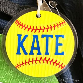 Just what I needed! Make softball crafts using this free softball svg from Carla Schauer Studio