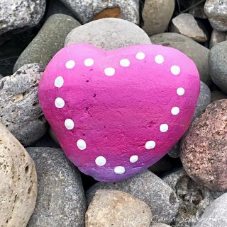 This would be adorable to make at camp! Ombre heart painted rock from Carla Schauer Designs. See easy painted rock ideas from carlaschauer.com. #easypaintedrocks #paintedrockideas #paintedrocks #rockpainting #decoratedrocks #ombre #heart #heartart #polkadots