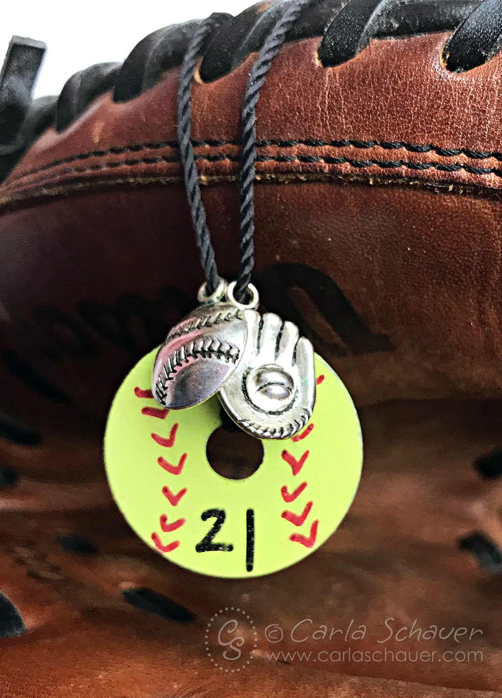 Softball Necklace displayed on softball glove
