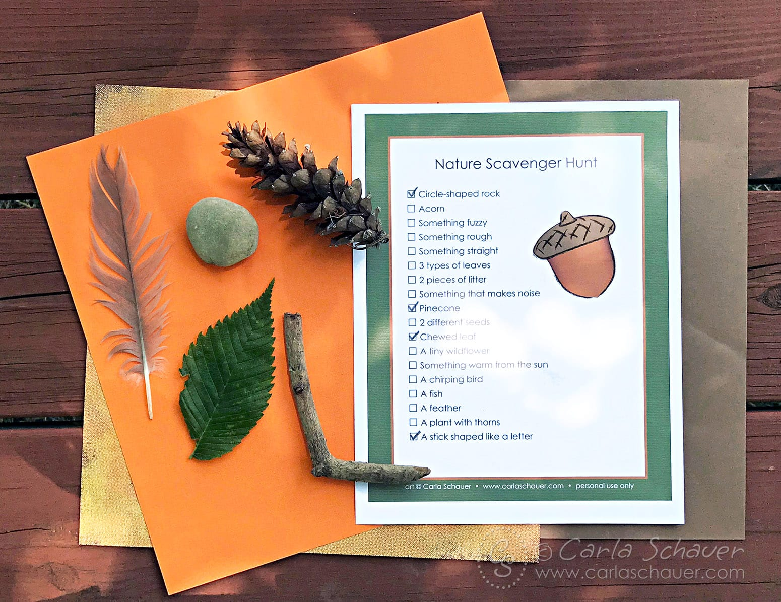 Printed Nature Scavenger Hunt Paper next to nature items.