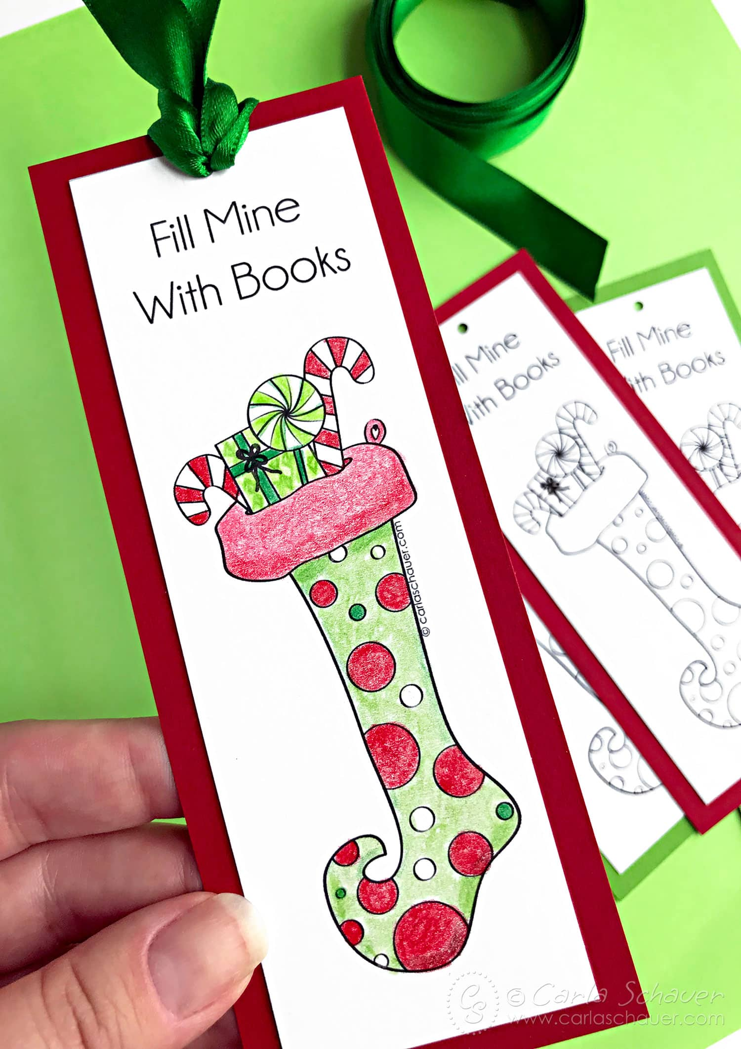 Colored stocking bookmark with red mat on green background.