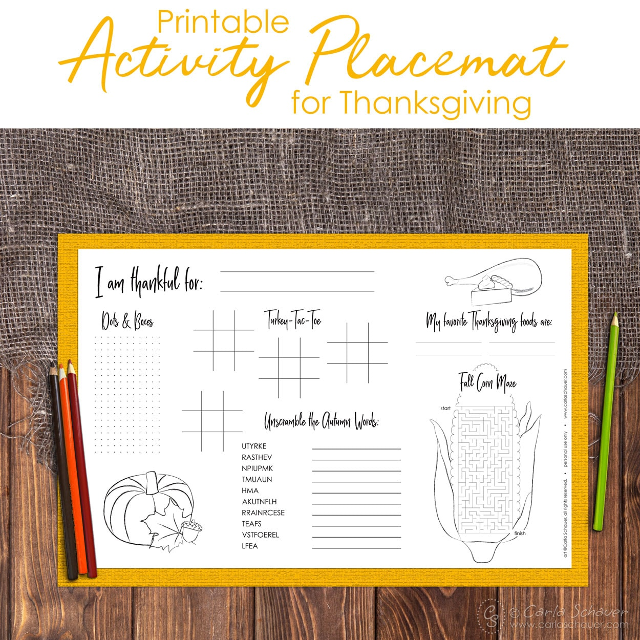 Thanksgiving activity placemat with yellow border and colored pencils on wood table. Includes text for pinning.