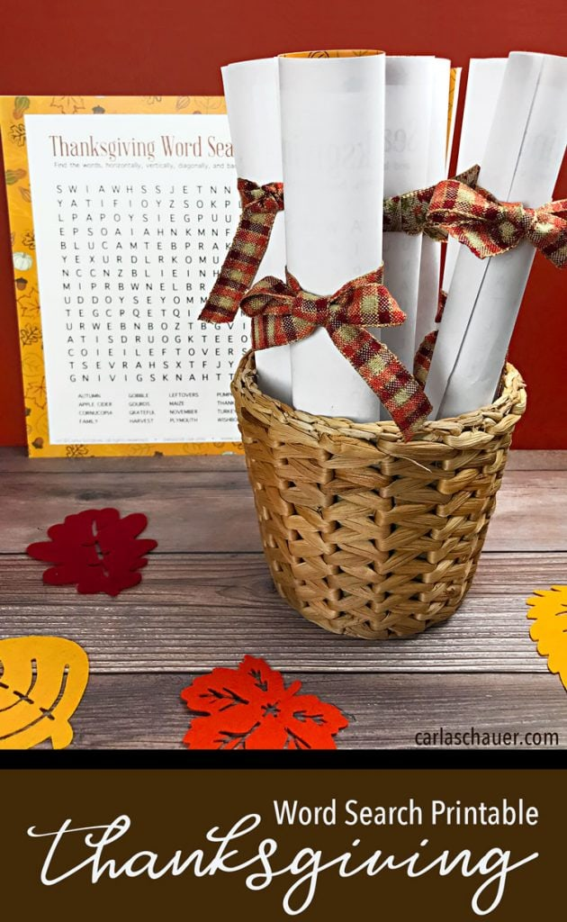 Printed Thanksgiving word searches rolled with fall ribbon bows in basket on wooden table with text for pinning.