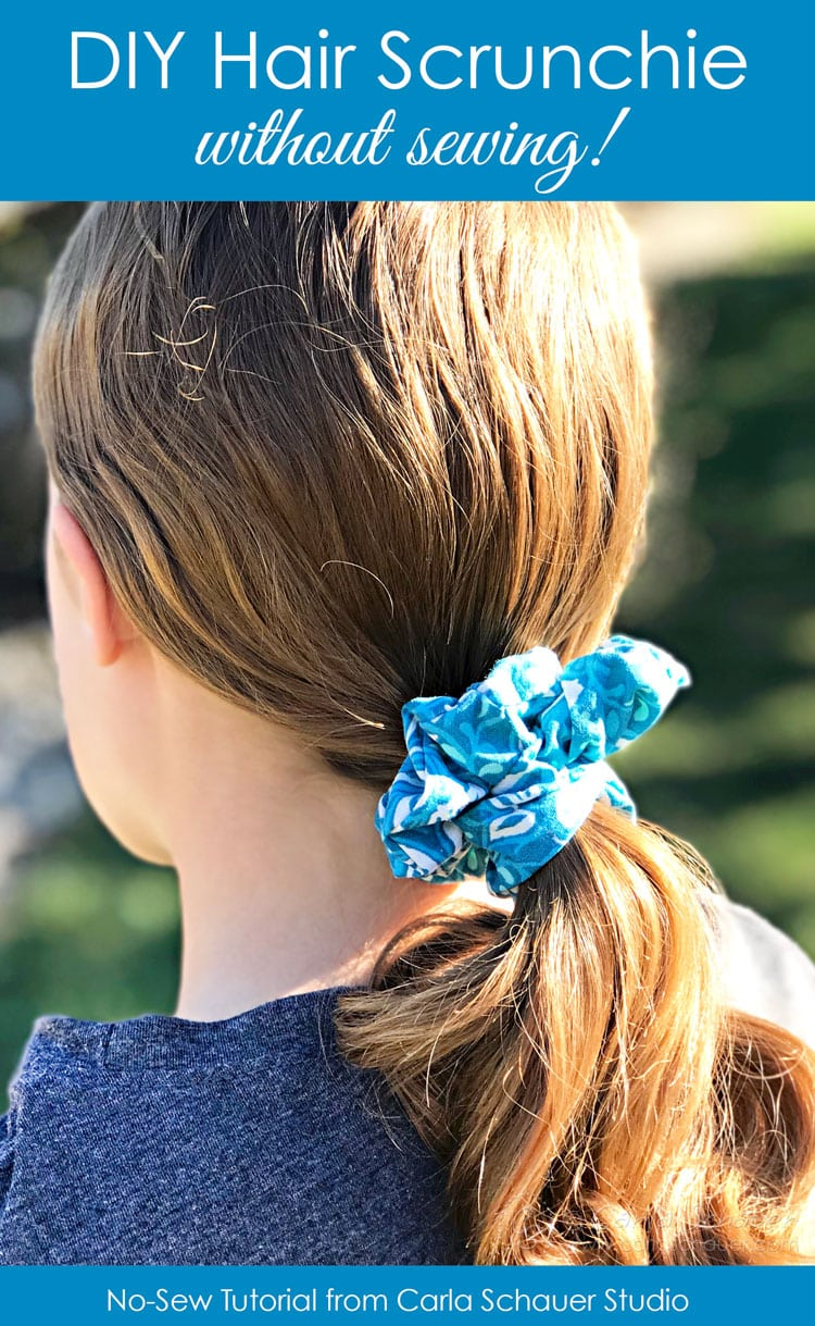 Blue Hair Scrunchie in ponytail of brown haired girl.