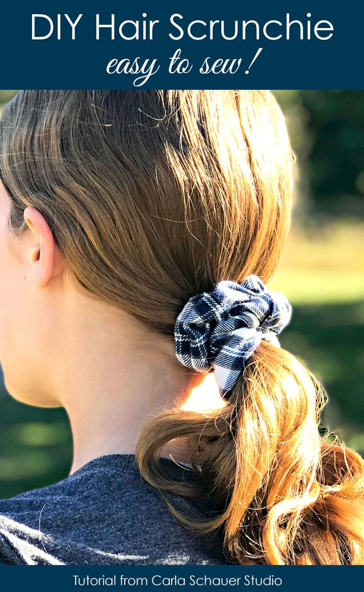Plaid flannel scrunchie in ponytail of brown haired girl.