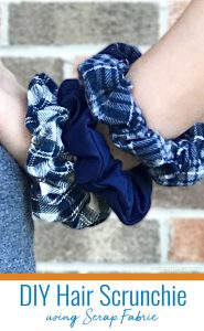 3 blue flannel scrunchies on girl's wrist.