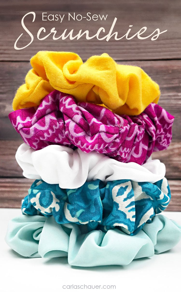 Stack of brightly colored DIY hair scrunchies in front of wood background.