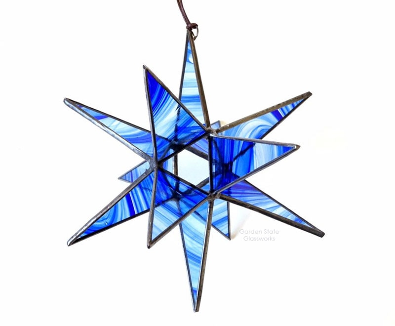 Blue Moravian Star Stained Glass on white background
