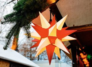 red and white moravian star hanging in holiday market