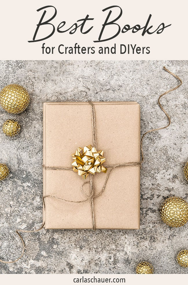 Wrapped gift on cement background with gold ornaments. Includes text for pinterest.