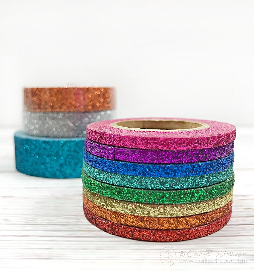 Stack of Glittery Tape on white background
