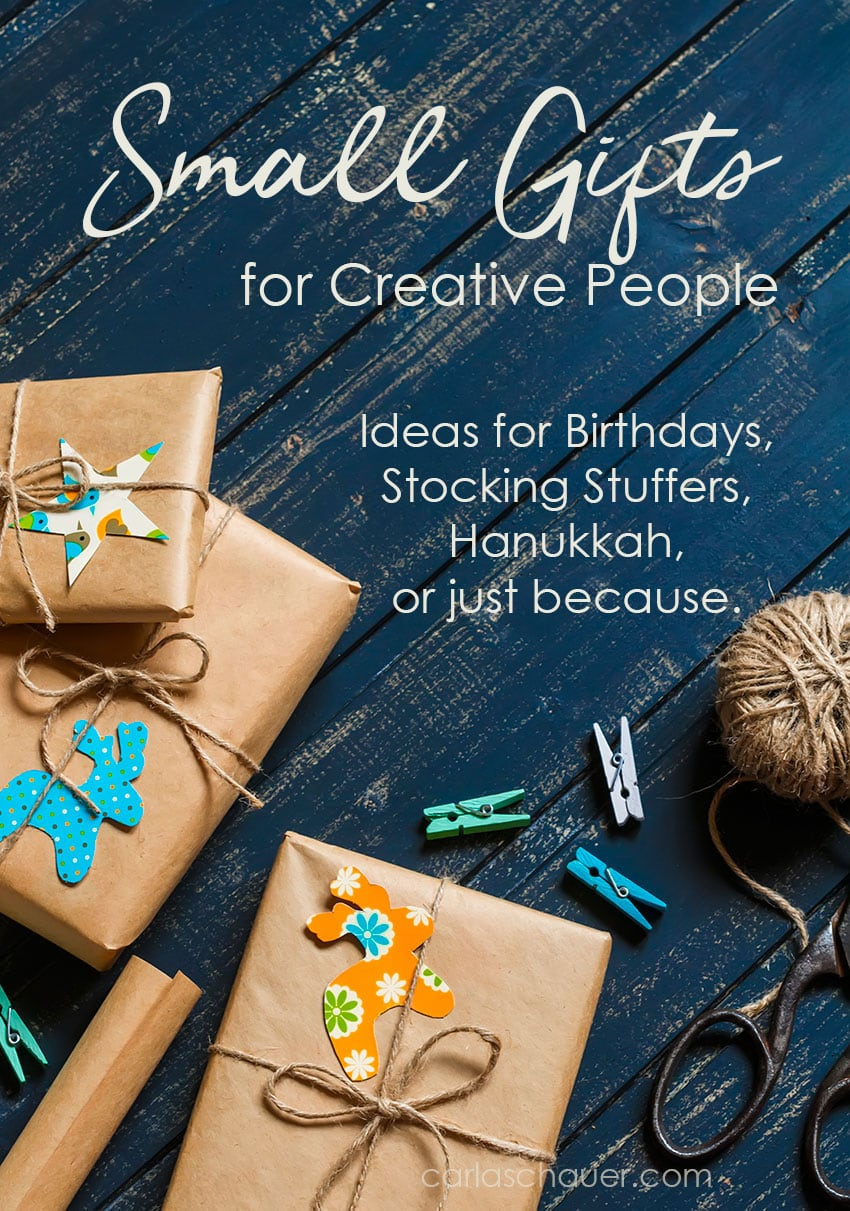 Small gifts wrapped in brown paper on blue background. Includes text overlay for pinterest.