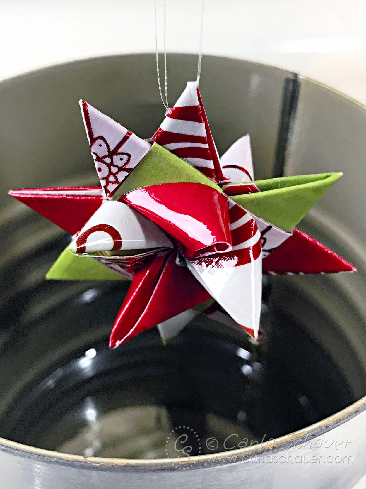 Folded German Star paper ornament after dipping in melted paraffin.