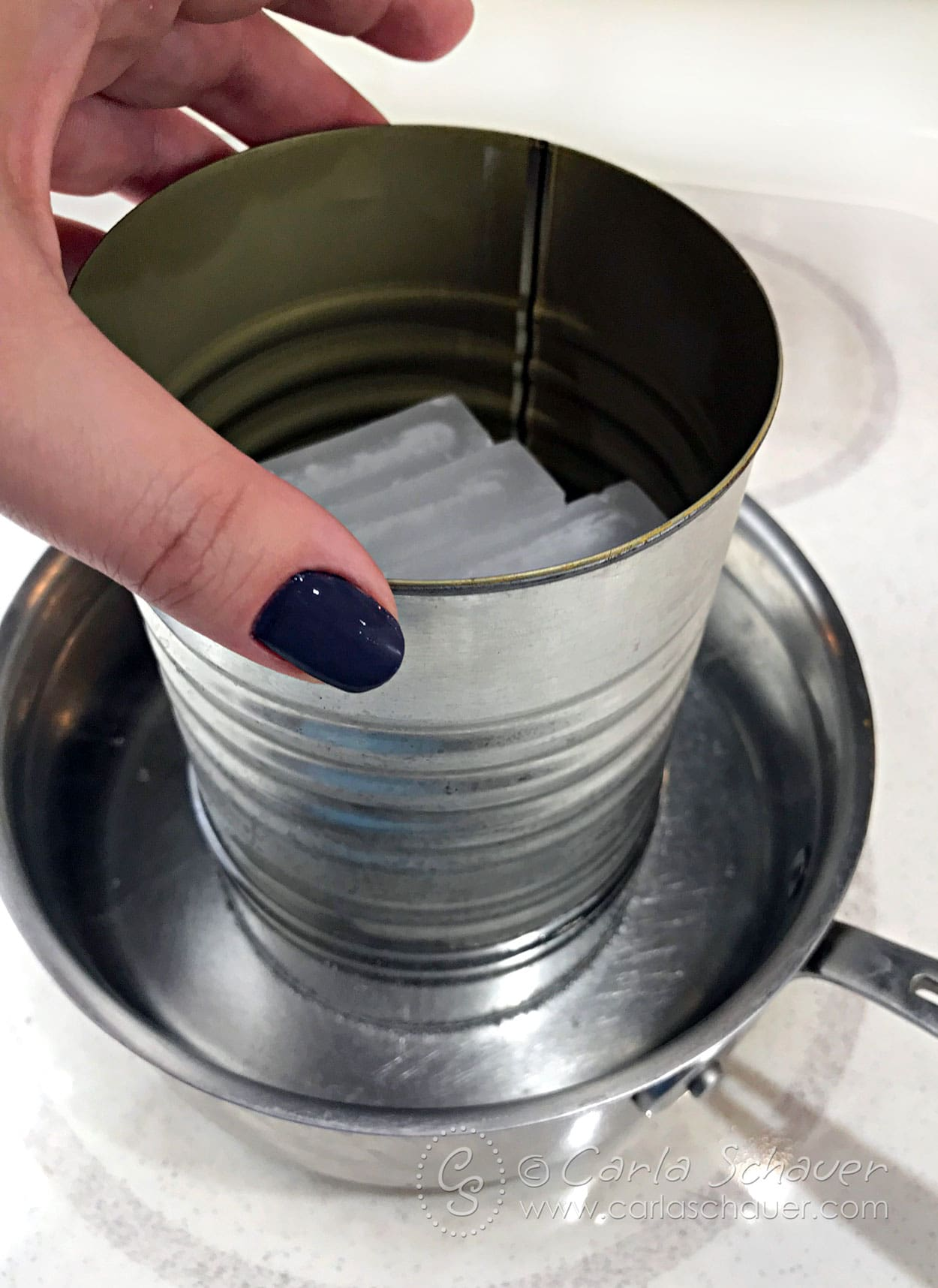 Can of paraffin wax blocks for melting.