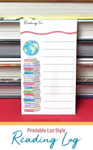 Printable reading log propped against stack of books.