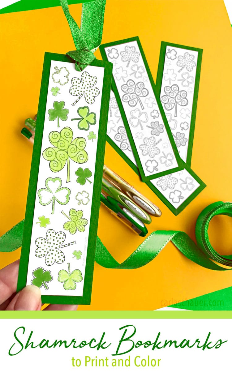 Colored shamrock printable bookmark held over yellow background.