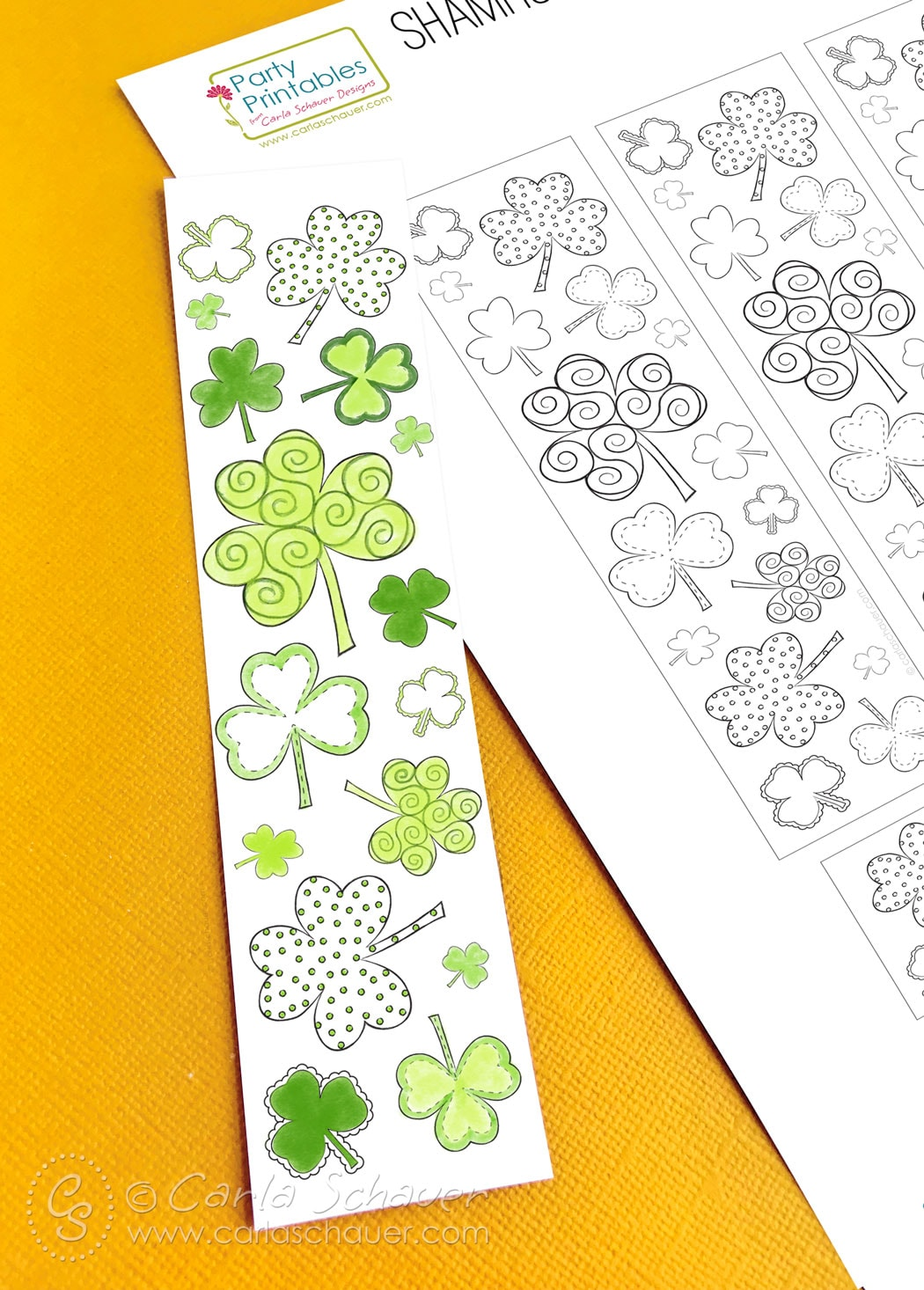 Colored shamrock printable bookmark and sheet on yellow background.