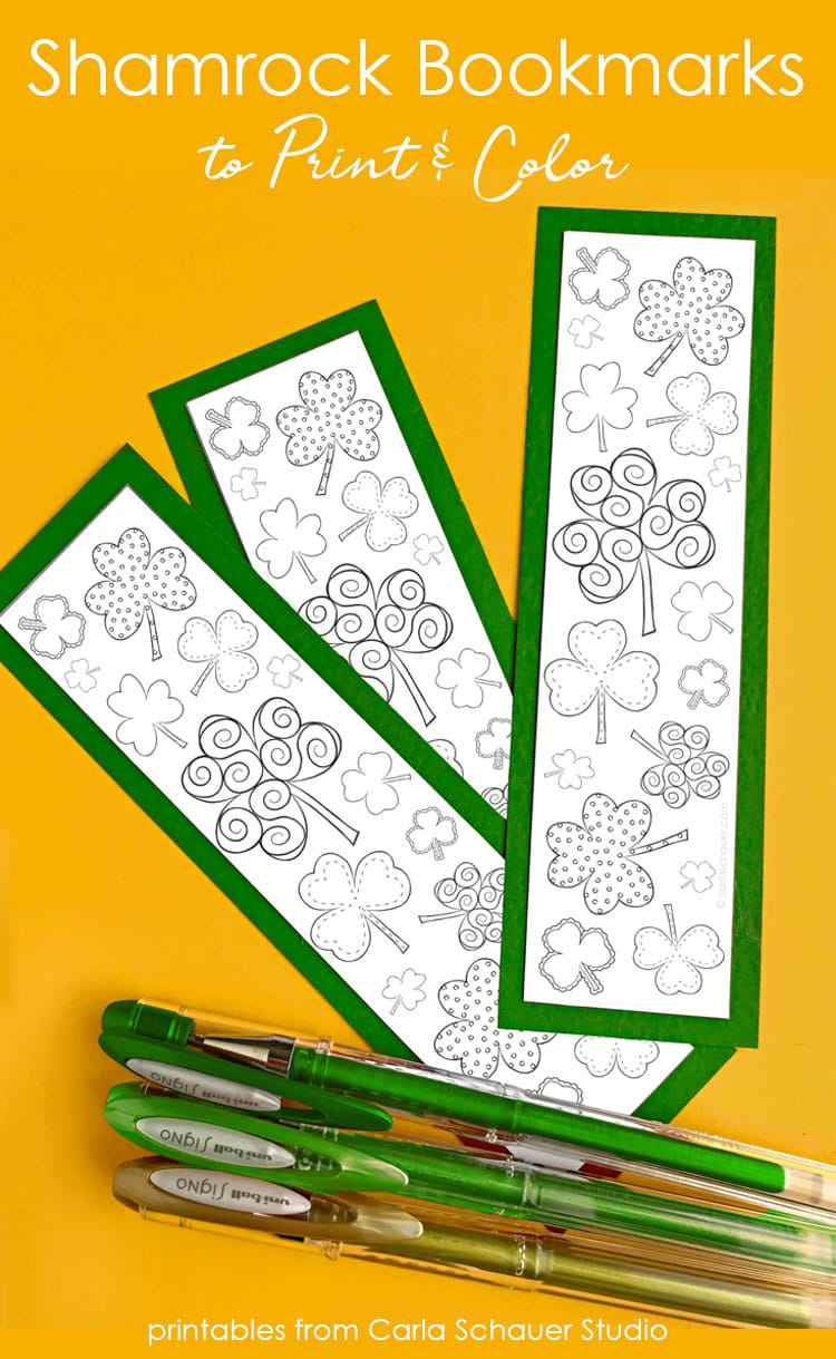 3 printed shamrock bookmarks and gel pens on yellow background.