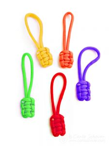 Paracord zipper pulls in multiple colors on white background