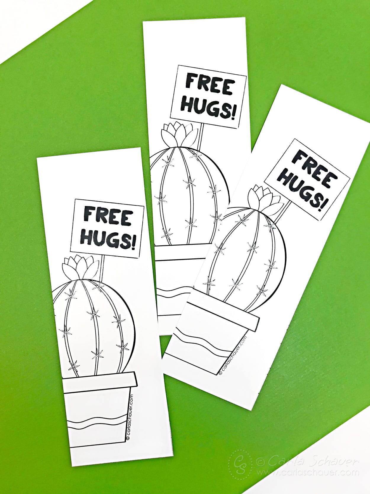 3 printed cactus pun bookmarks on green background