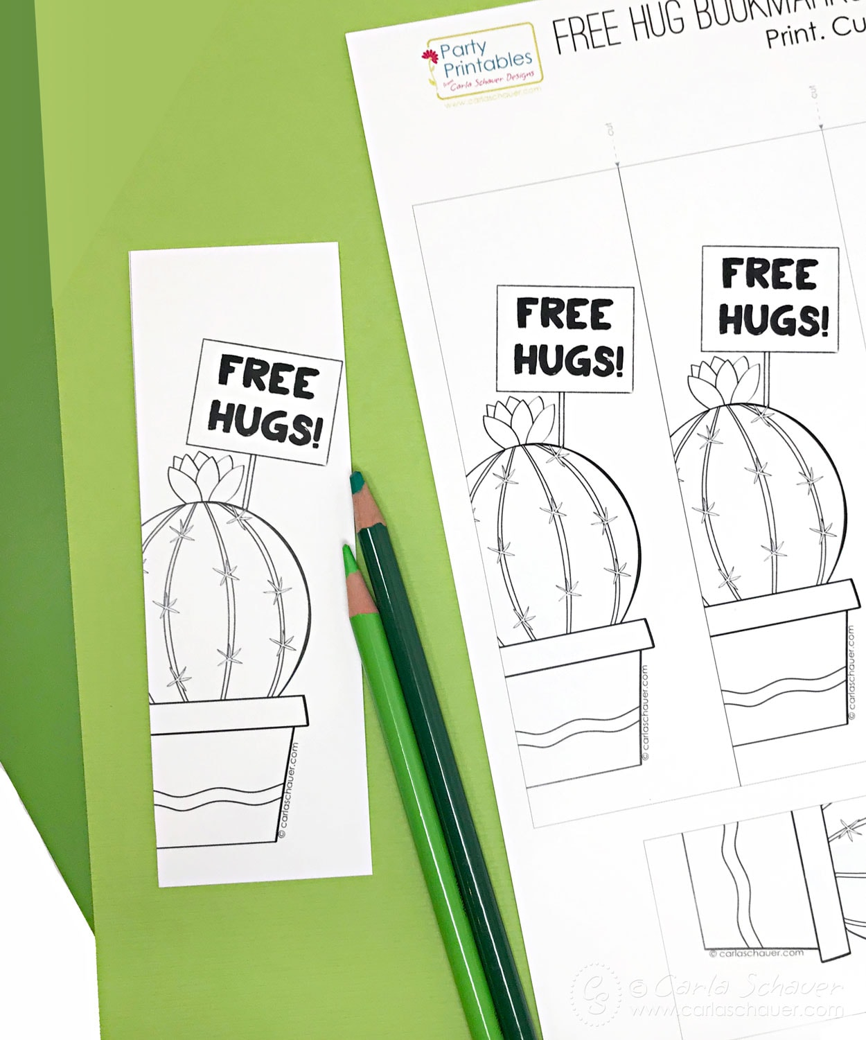 Printed cactus bookmark sheet and colored pencils on green background