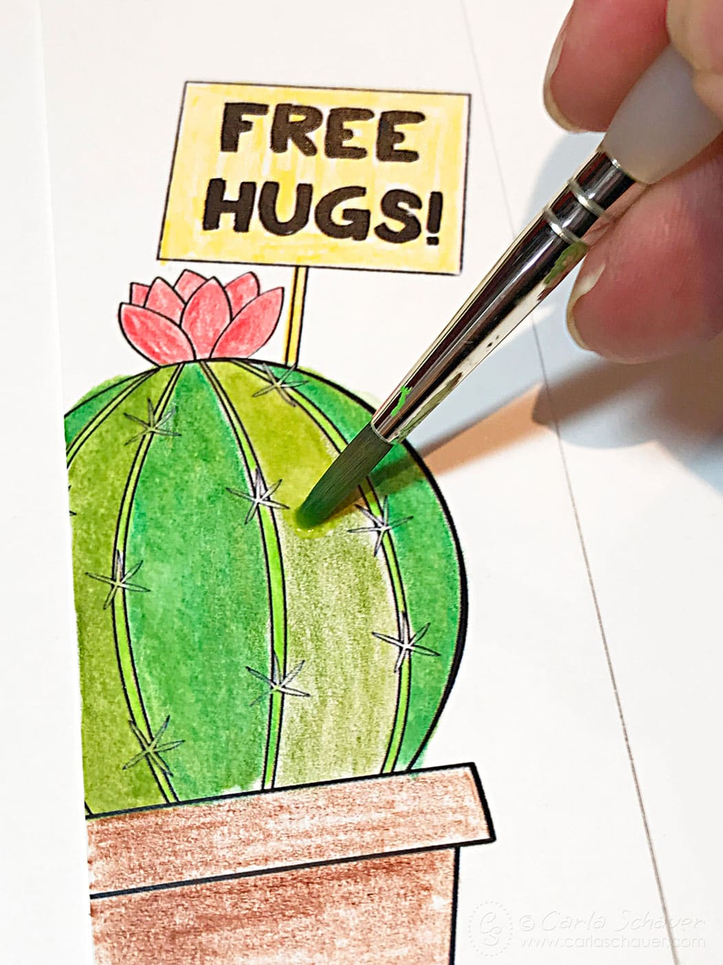 Water blending colored pencils on printable cactus bookmark.