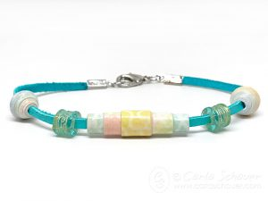 Rainbow Bracelet made with paper beads on white background.