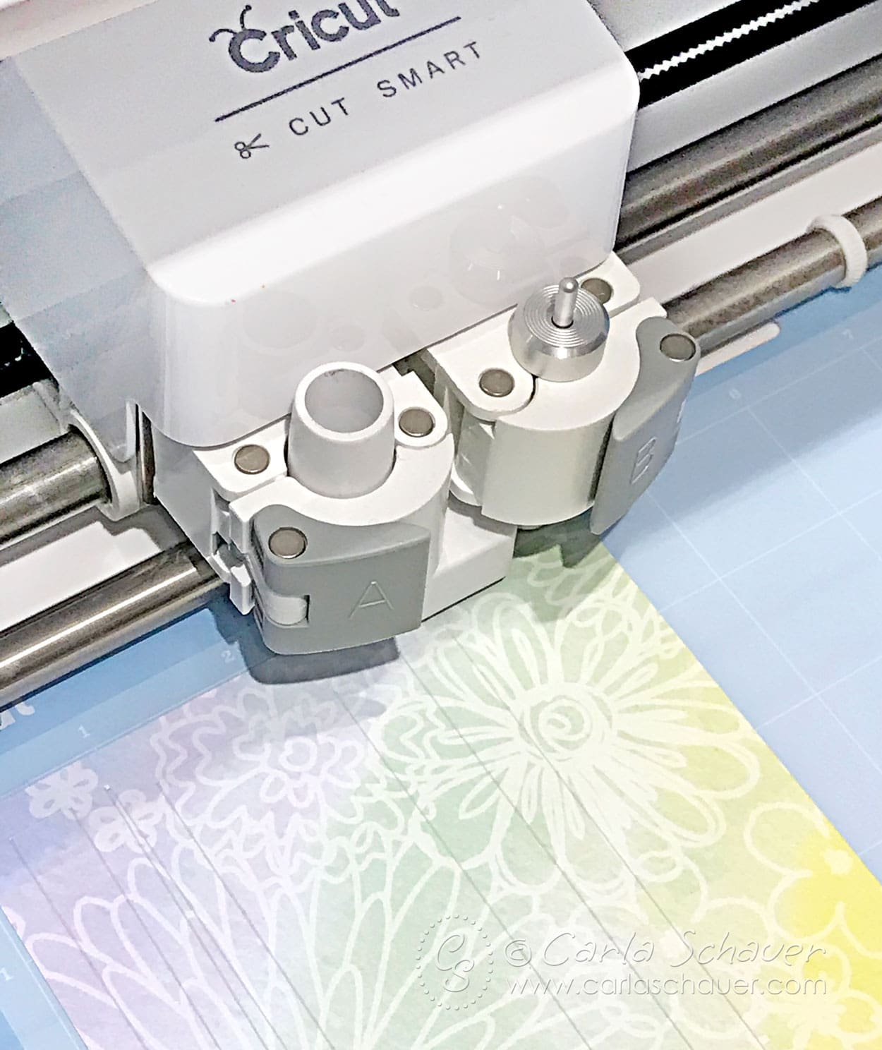 Cricut machine cutting paper beads.