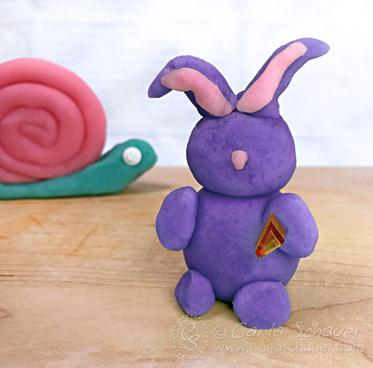 Rabbit and snail made from homemade playdough.