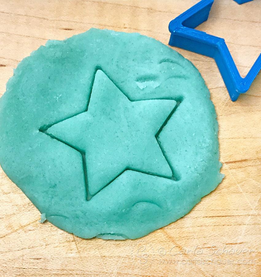 Cutting star shape from DIY Playdough.